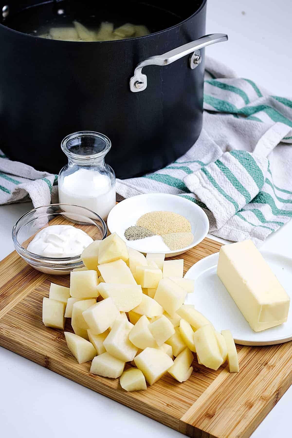 Ingredients to Make mashed potatoes on cutting board