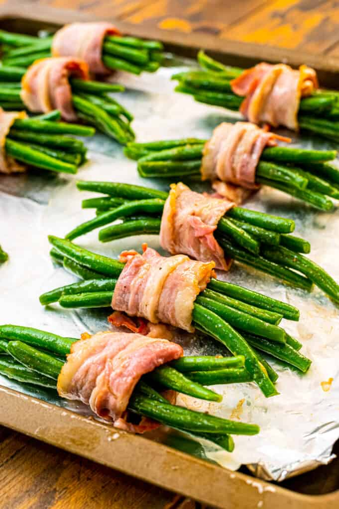 Green Bean Bundles on a sheet pan lined with foil before baking