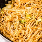 Skillet with chow mein in it