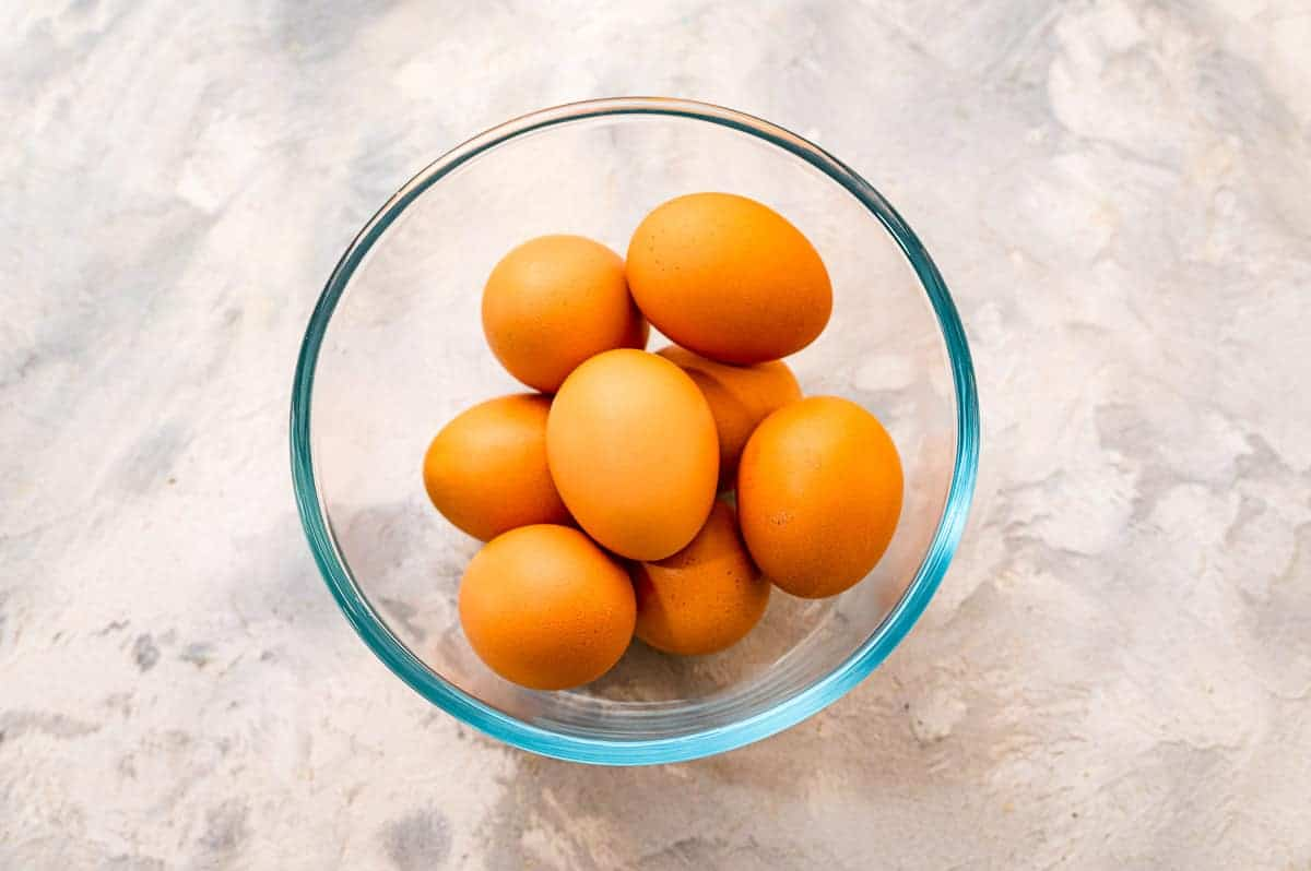 Overhead image of glass bowl with brown eggs in it