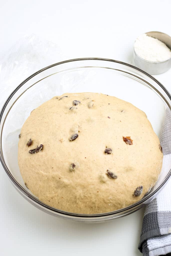Glass bowl with proofed dough for hot cross buns