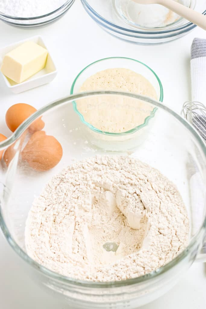 Flour mixture to make buns in glass bowl
