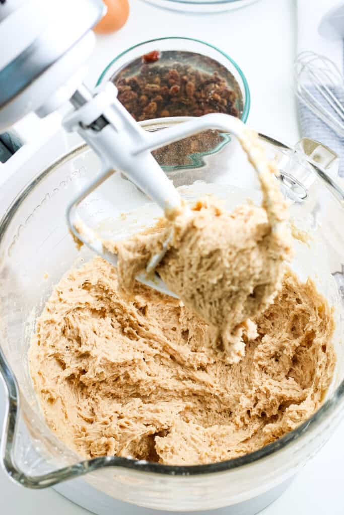 Dough for hot cross buns mixed up in stand mixer bowl