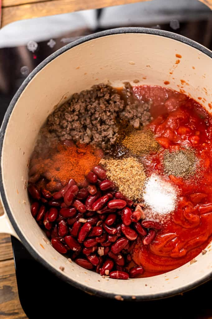 Dutch oven with ingredients in it for chili mac before stirring