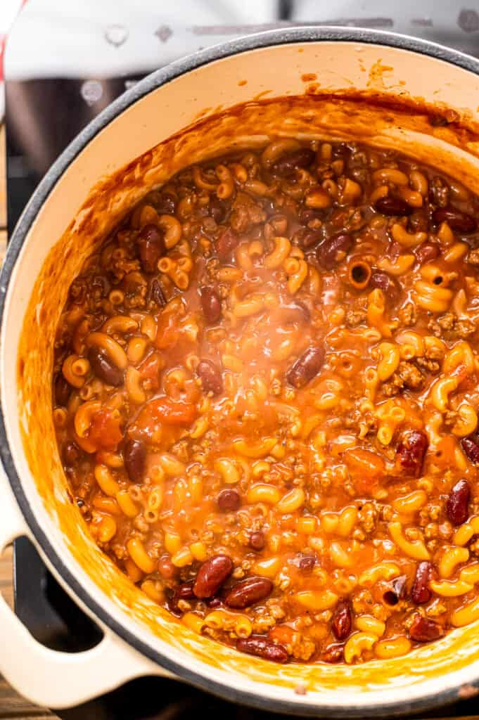 Overhead image of chili mac simmering in dutch oven
