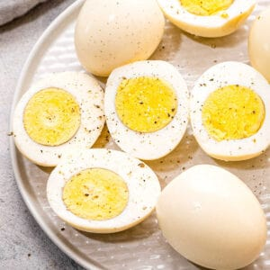 Pressure Cooker Hard Boiled Eggs on plate Square cropped image