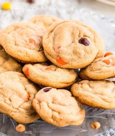 Reese's Pieces Peanut Butter Cookies on a glass platter