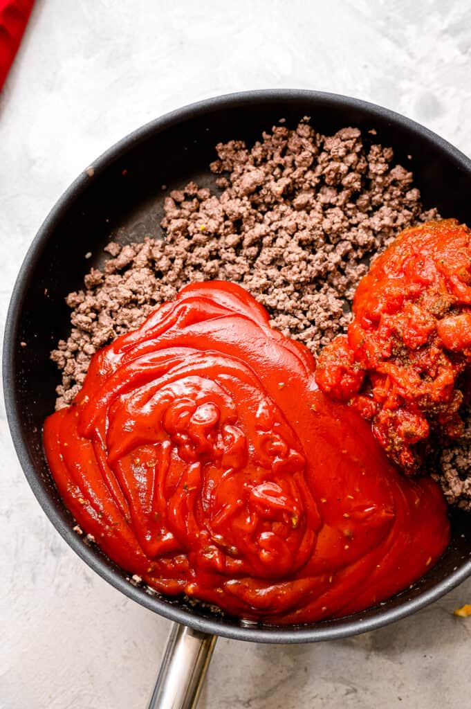 Making meat sauce in skillet for lasagna