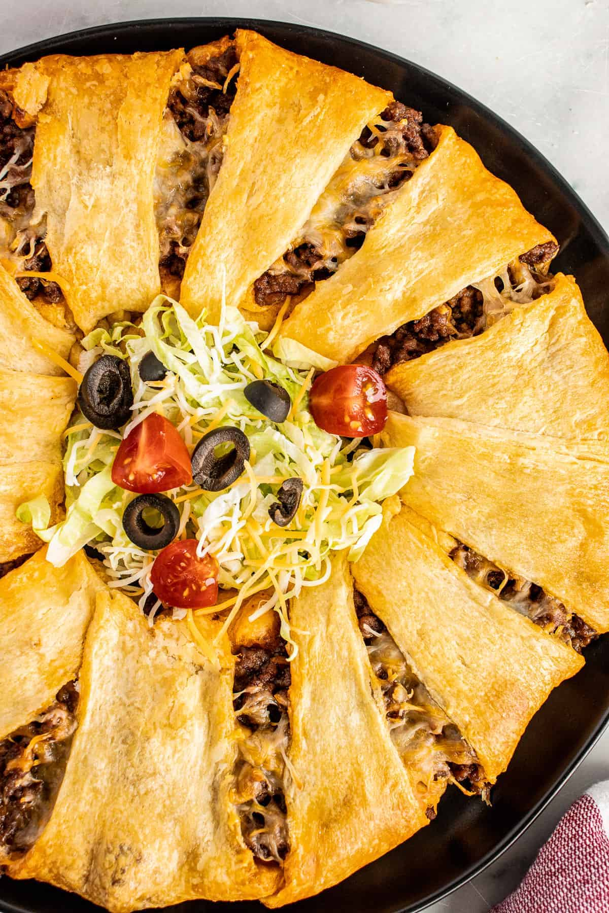 Taco Ring on dark plate with taco toppings in center