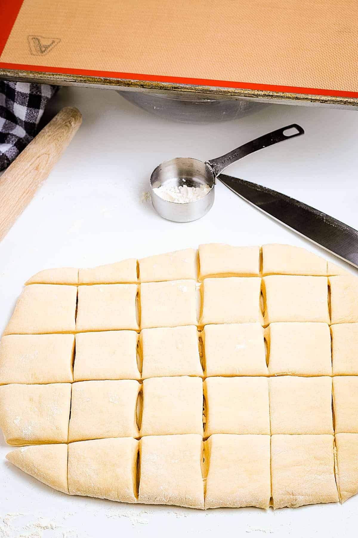 Roll dough rolled out and scored into squares