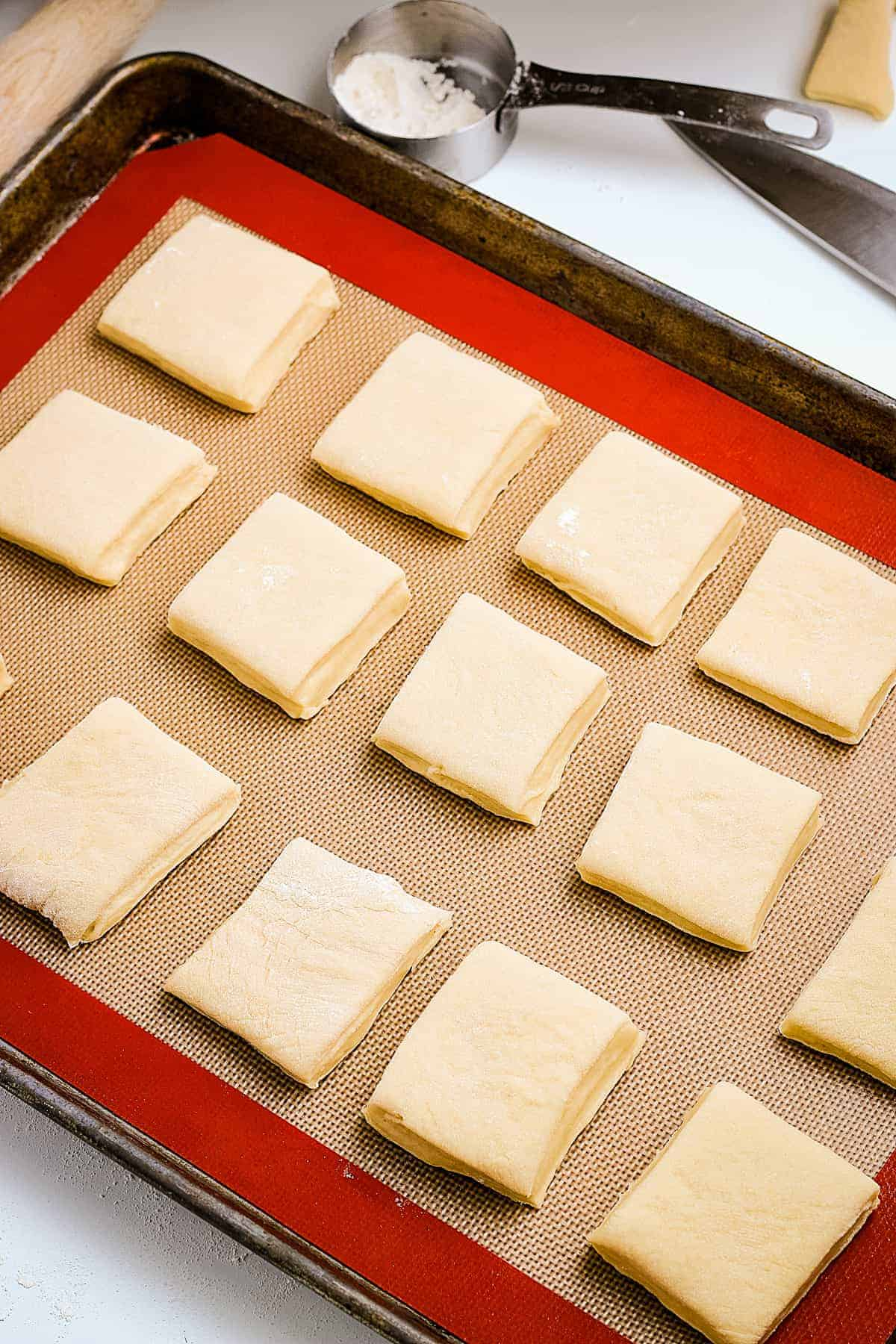 Baking sheet with roll dough before proofing