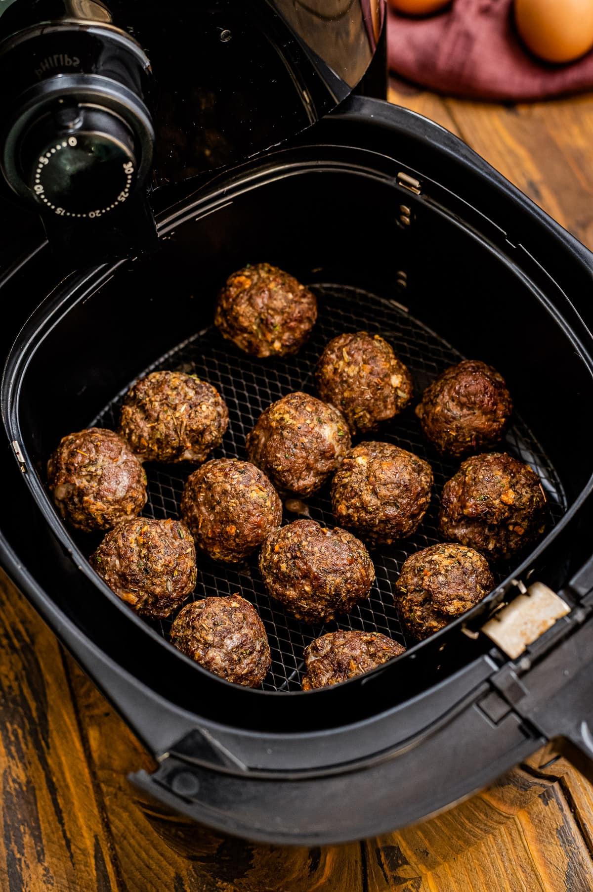 Cooked Air Fryer Meatballs in air fryer basket