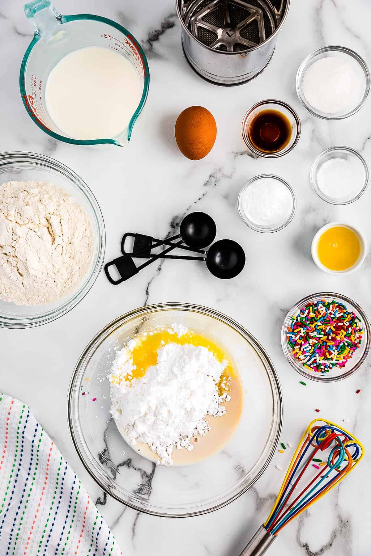 Ingredients in glass bowl to make frosting for funfetti pancakes