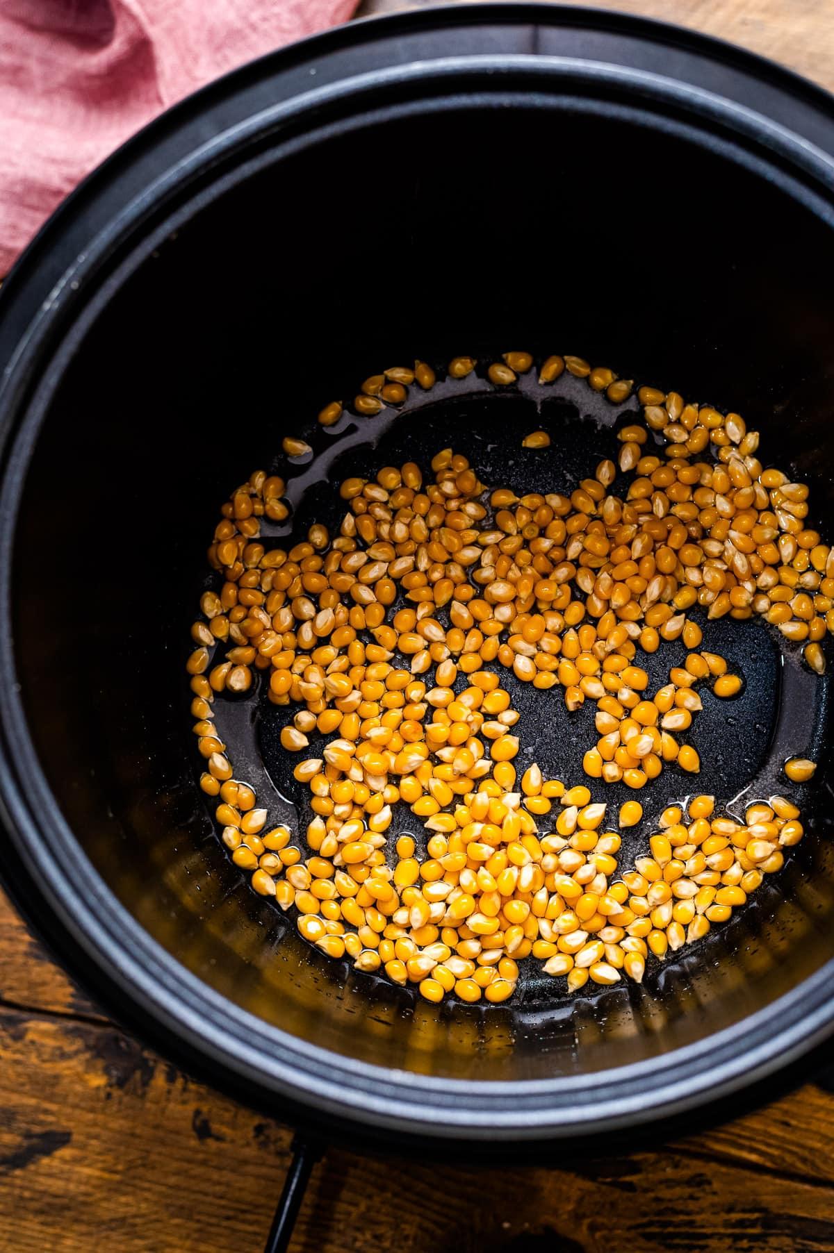 Instant Pot with popcorn kernels in oil
