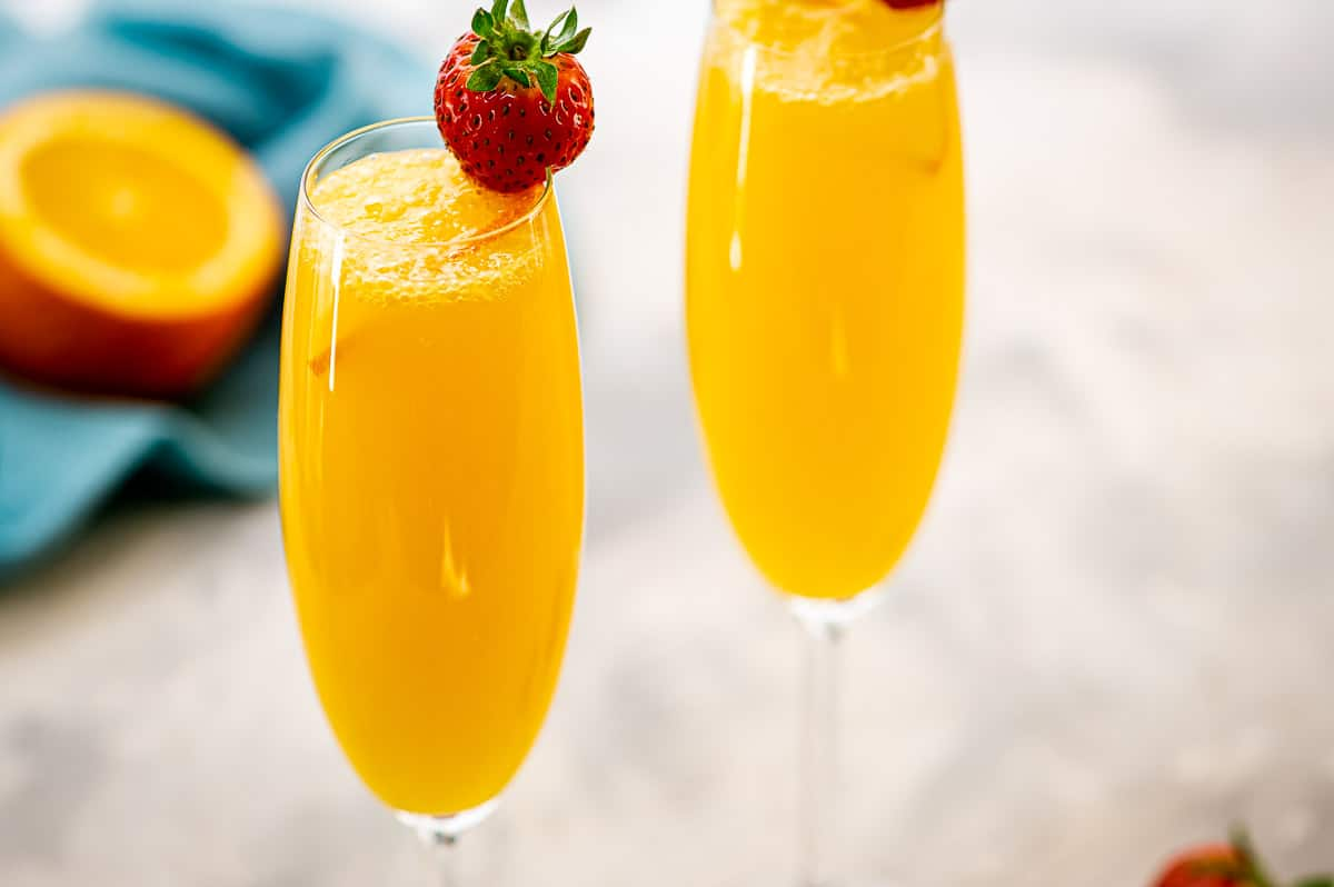 Mimosa Cocktails in champagne glasses