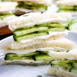 Close up image of stacked cucumber sandwiches