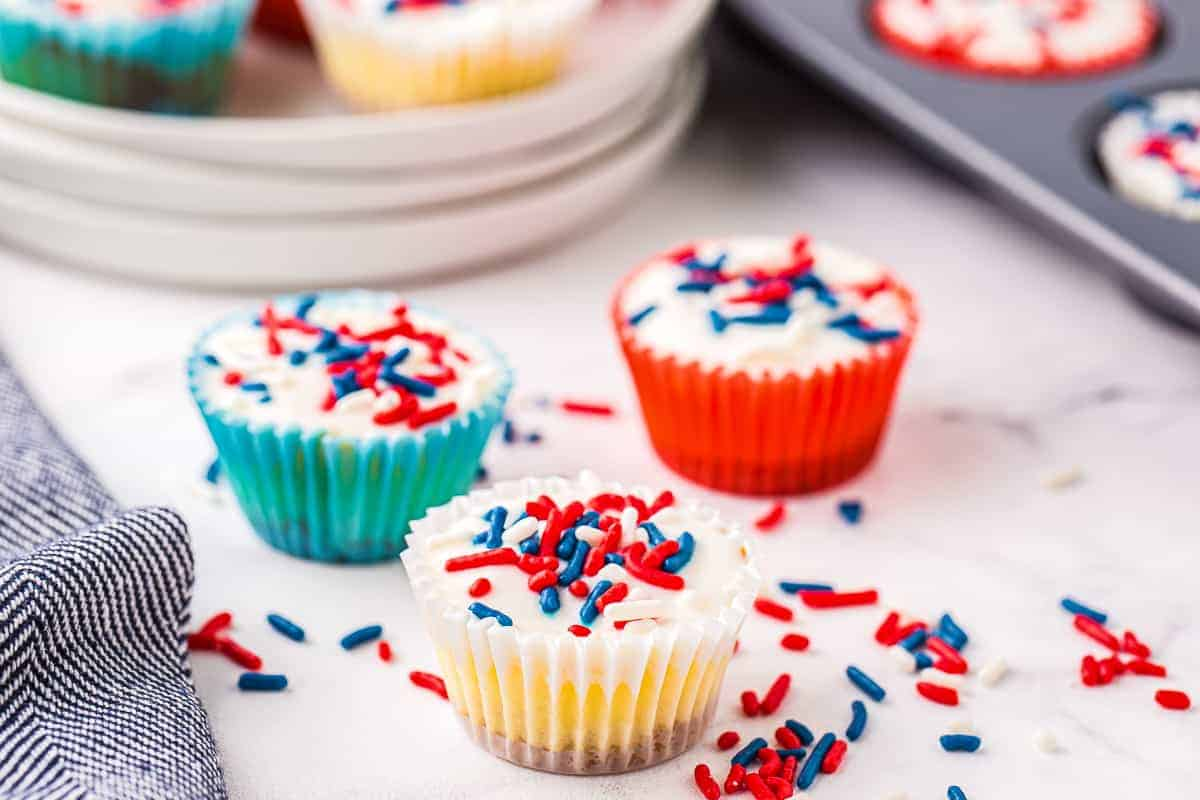 Set of three Red White and Blue Mini Cheesecakes on marble background
