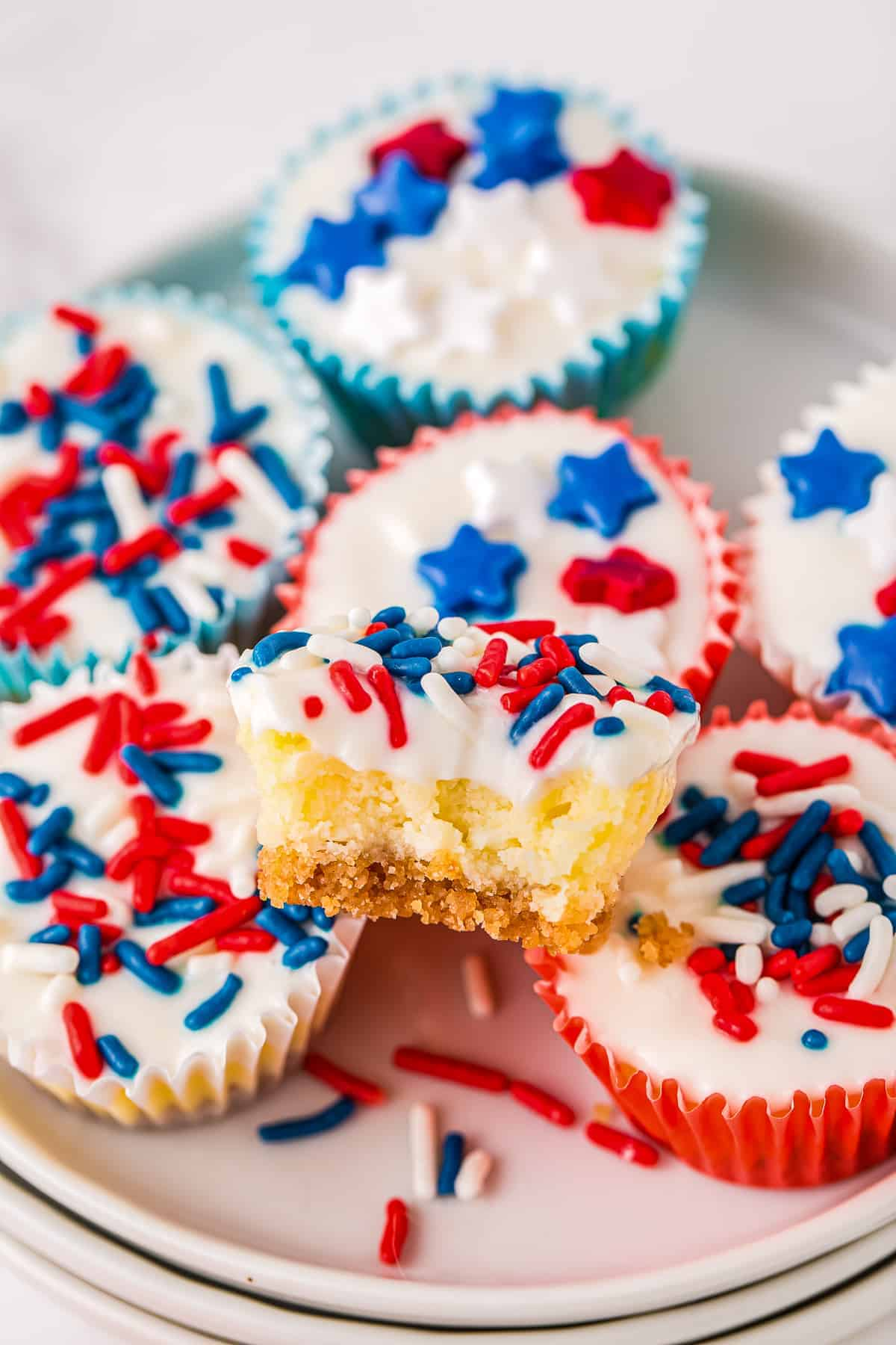 Red White and Blue Mini Cheesecakes stacked on white plate