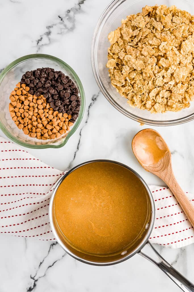 The peanut butter mixture for cereal bars in saucepan