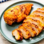 Air Fryer Chicken Breast sliced and plated on blue plate