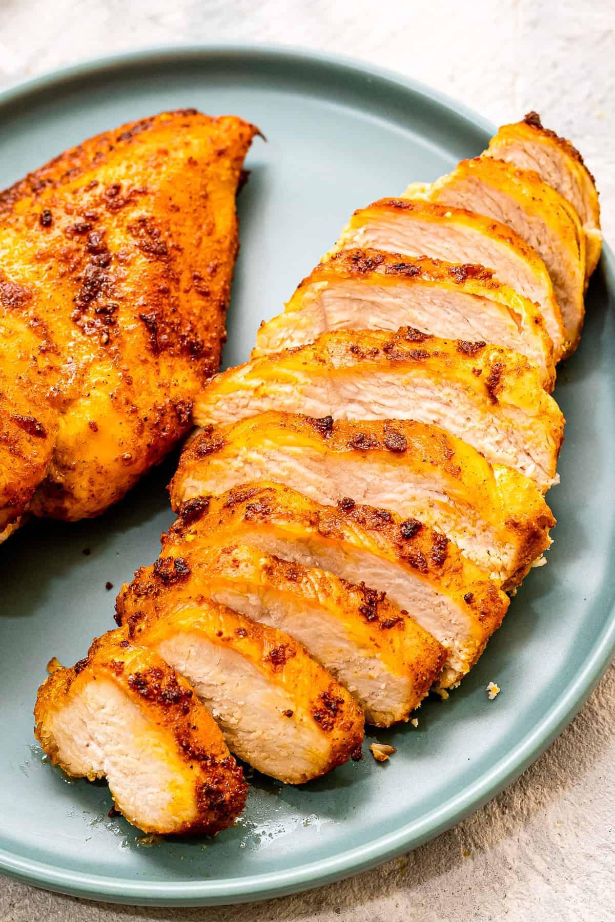 Air Fryer Chicken Breast Sliced on blue plate