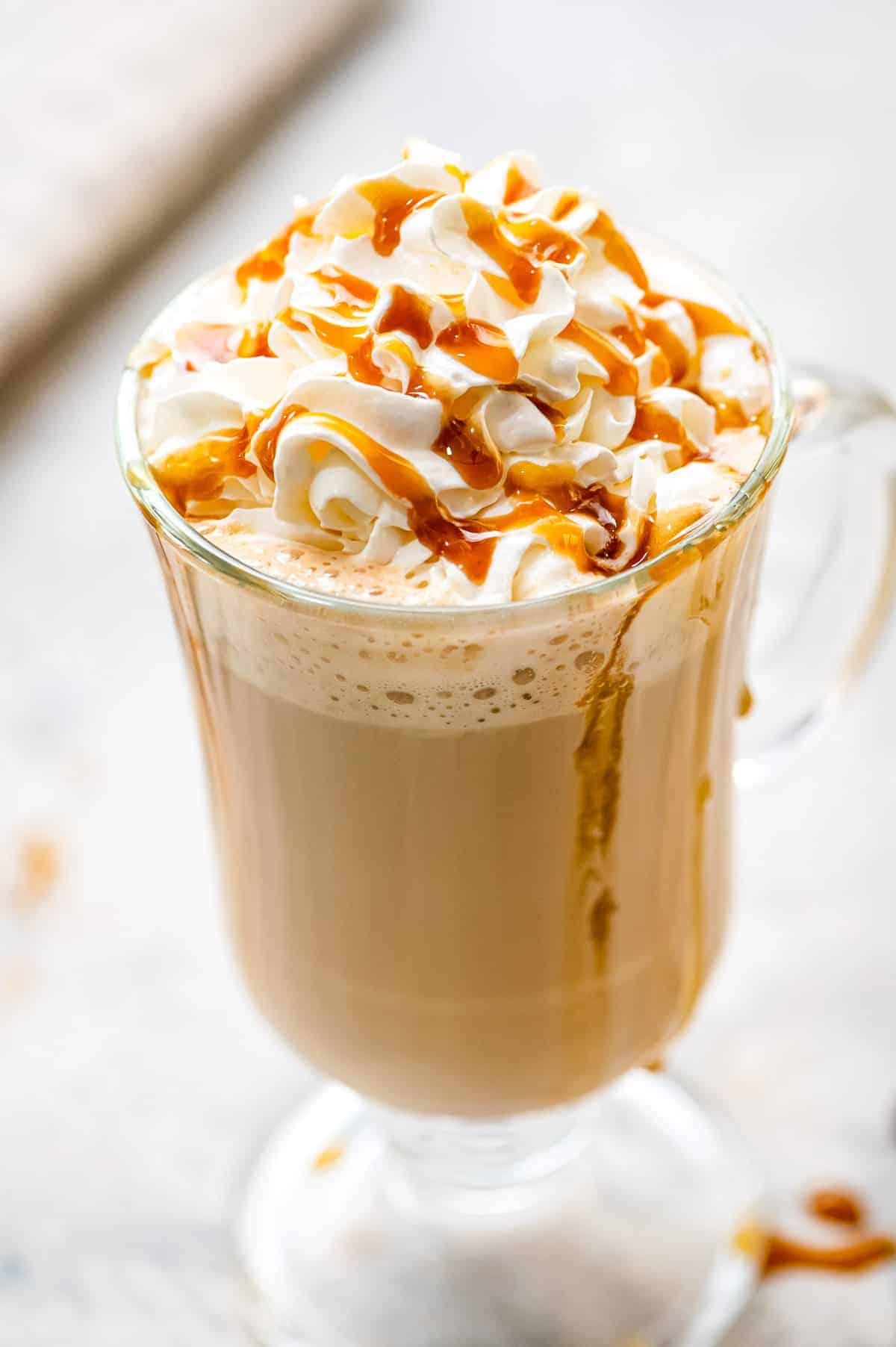Caramel Latte in a glass with whipped topping and caramel sauce