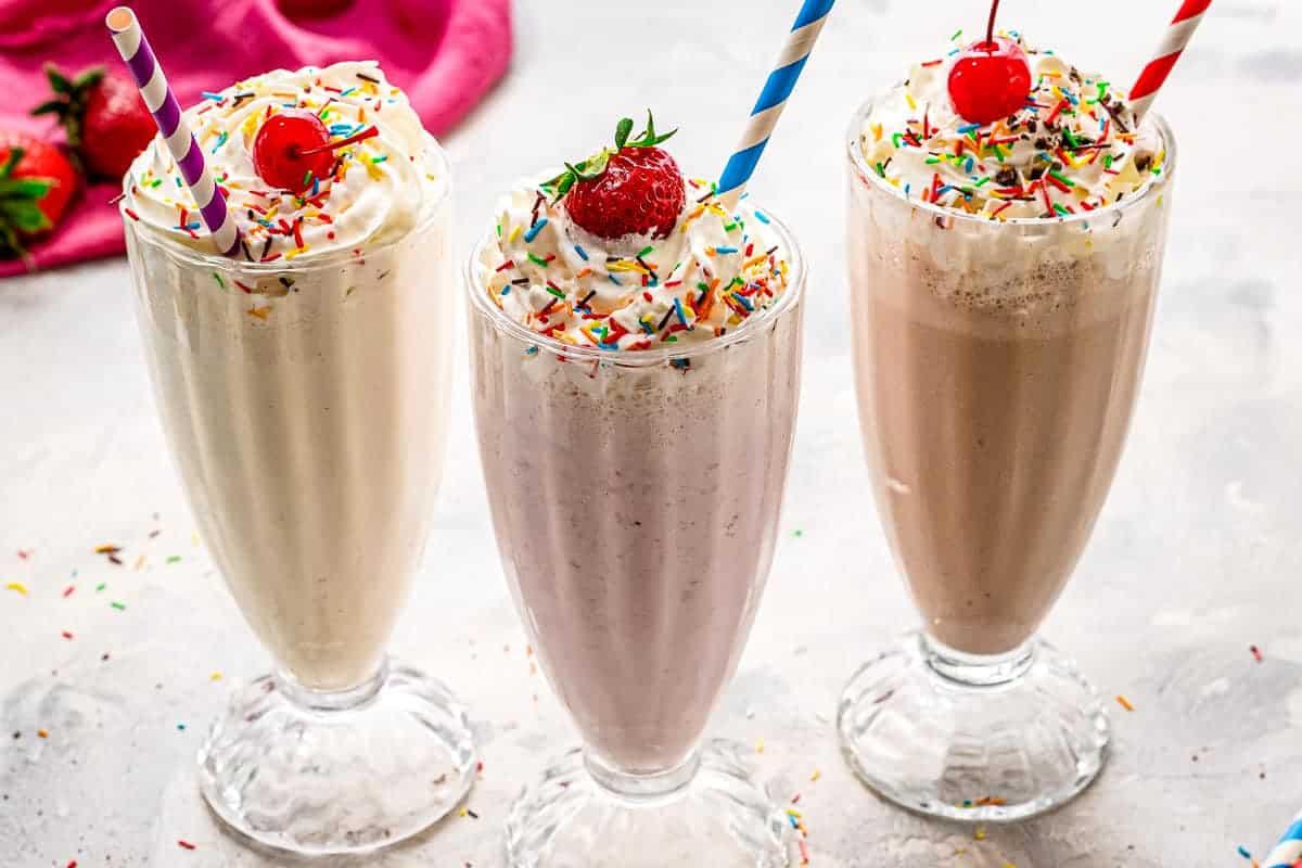 Set of three milkshakes in vanilla, strawberry and chocolate