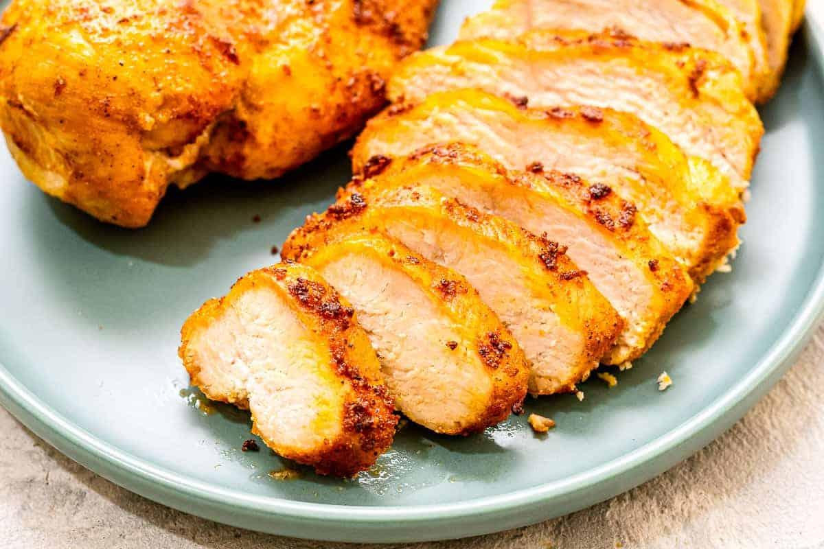 Sliced Seasoned Chicken Breast on blue plate
