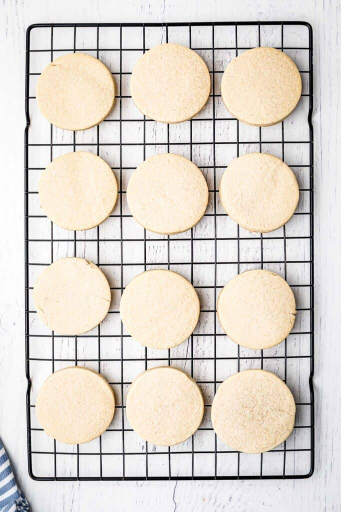 Round sugar cookies cooling on wire rack