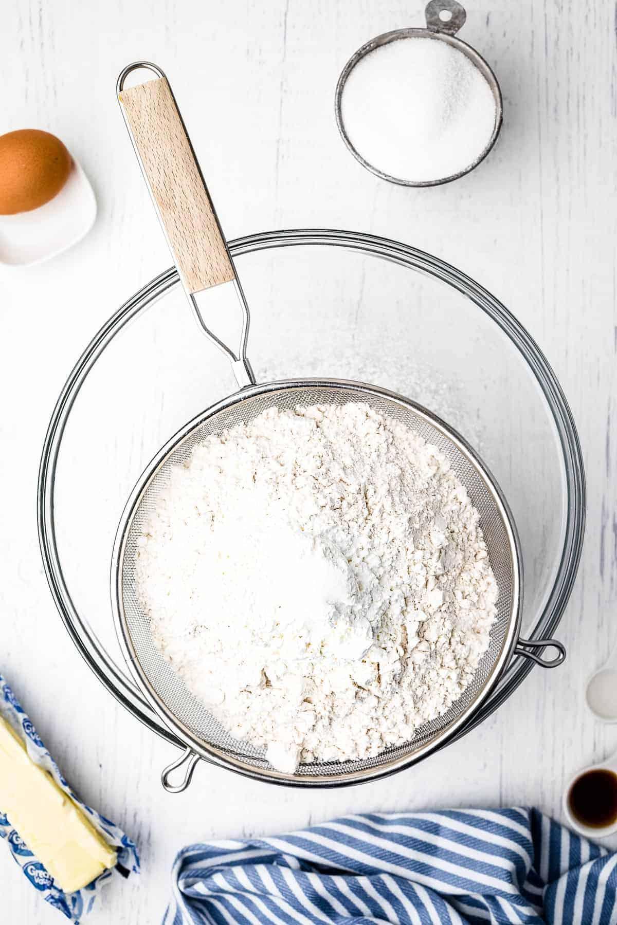 Sifting dry ingredients for sugar cookies