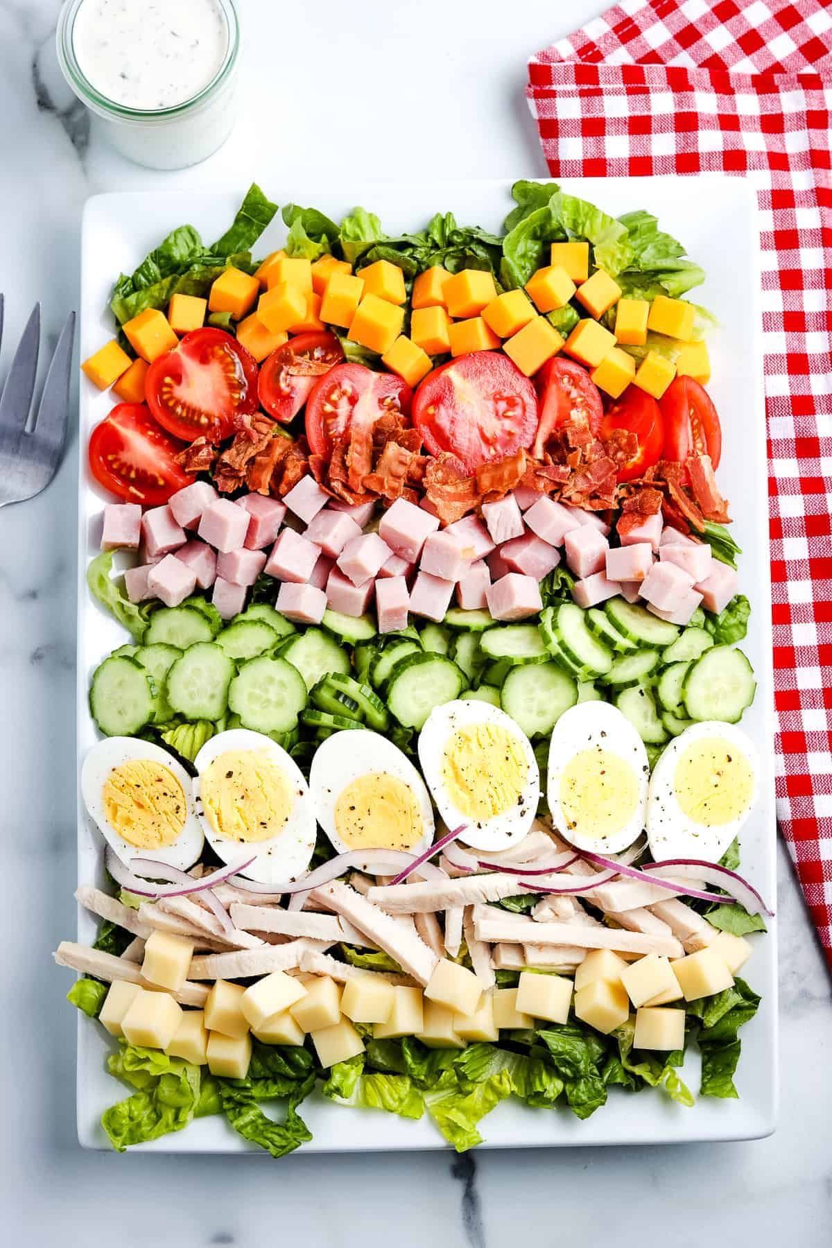 Overhead image of white rectangle platter with Chef Salad