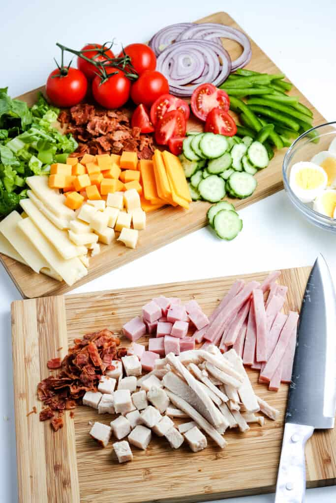 Cutting board with ham and turkey
