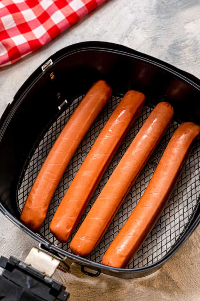 Hot dogs in air fryer baskets