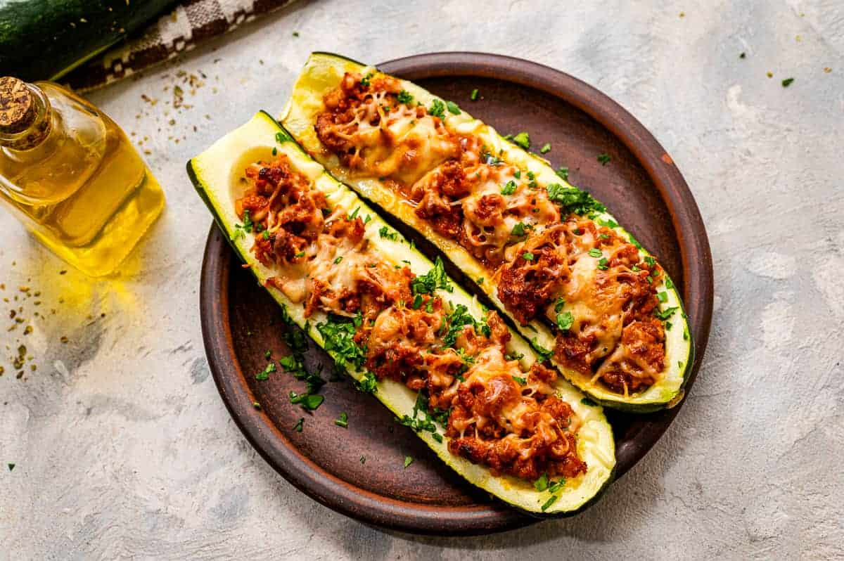 Stuffed Zucchini Boats on a wood plate
