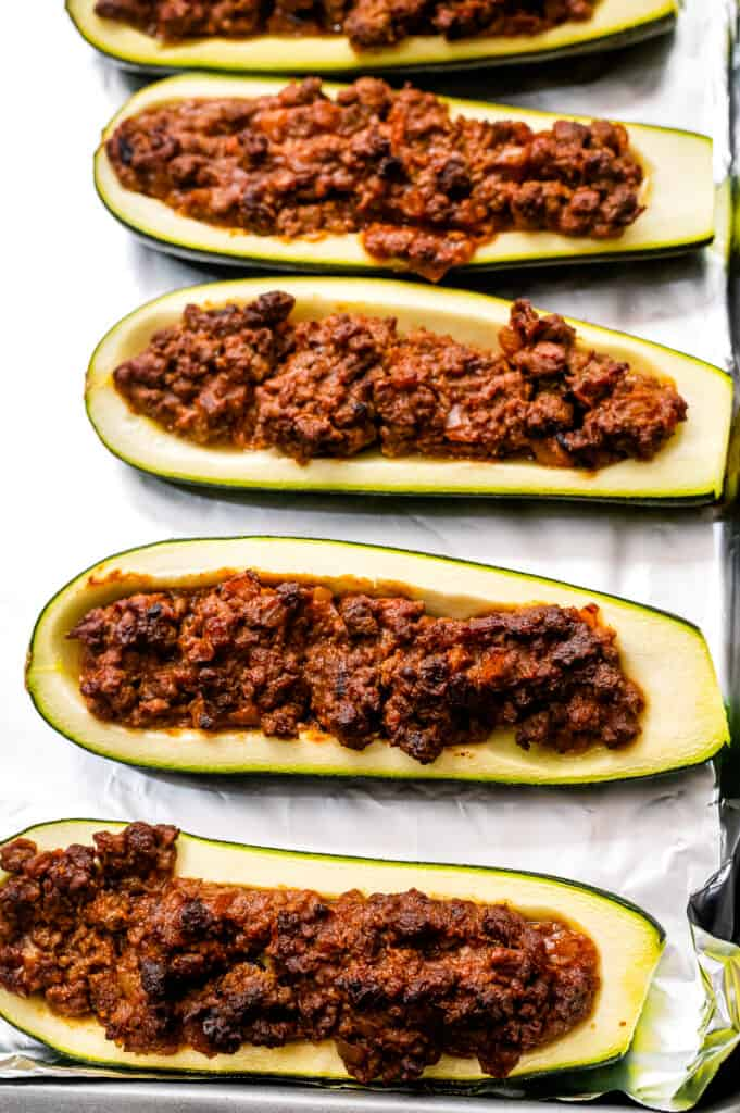 Zucchini with taco meat mixture in them after baking