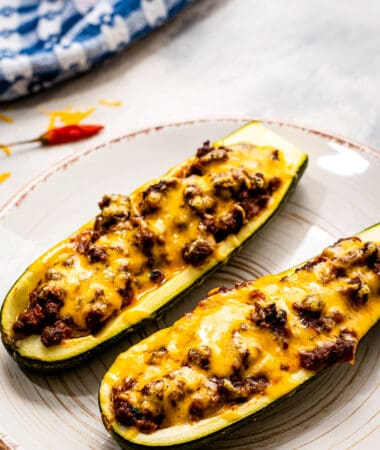 Plate with two taco stuffed zucchini boats