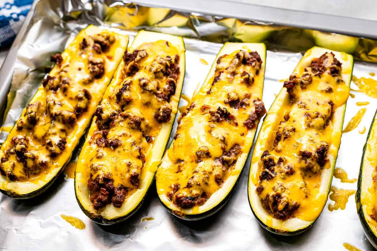 Foil lined pan with baked Taco Stuffed Zucchini Boats
