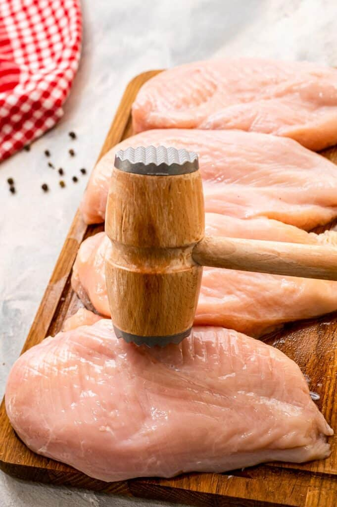 Meat mallet pounding chicken breasts