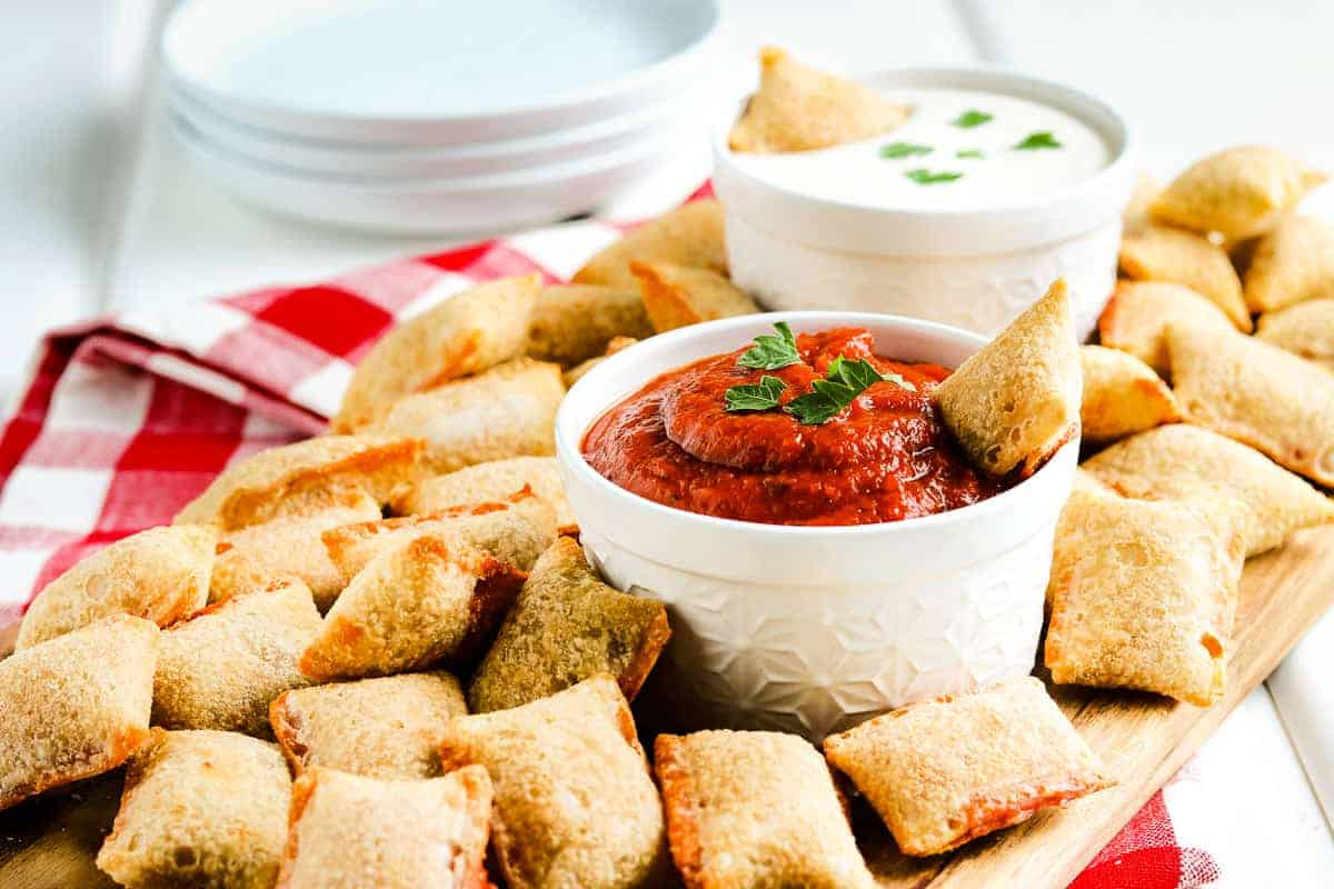 Photo of cooked pizza rolls and marinara sauce