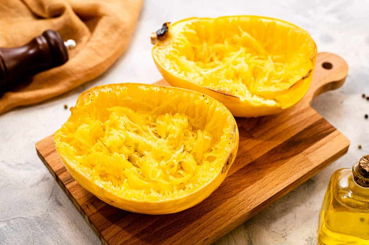 Two halves of spaghetti squash face up that are roasted