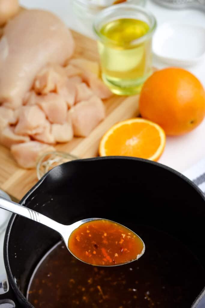 Orange sauce on spoon