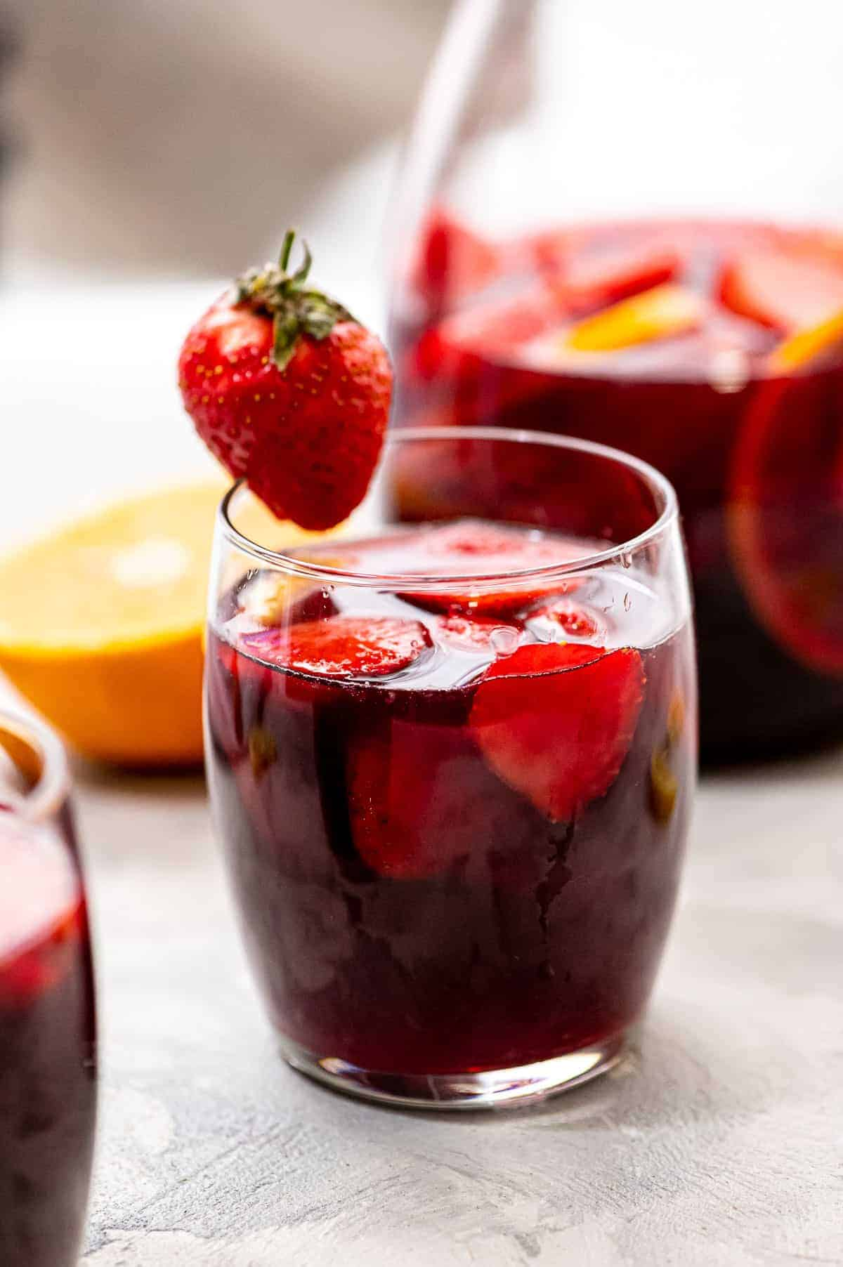 Glass of Red Sangria garnished with a strawberry
