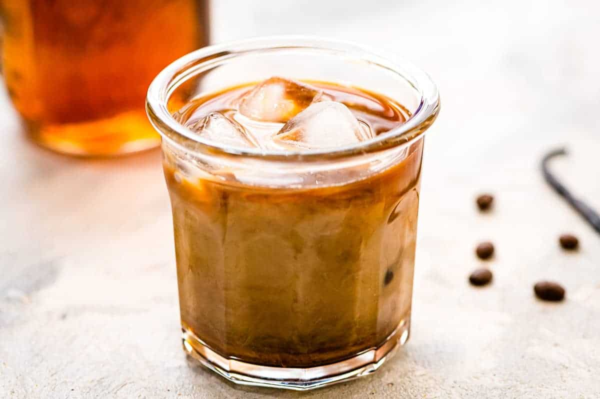 Glass of iced coffee with creamer