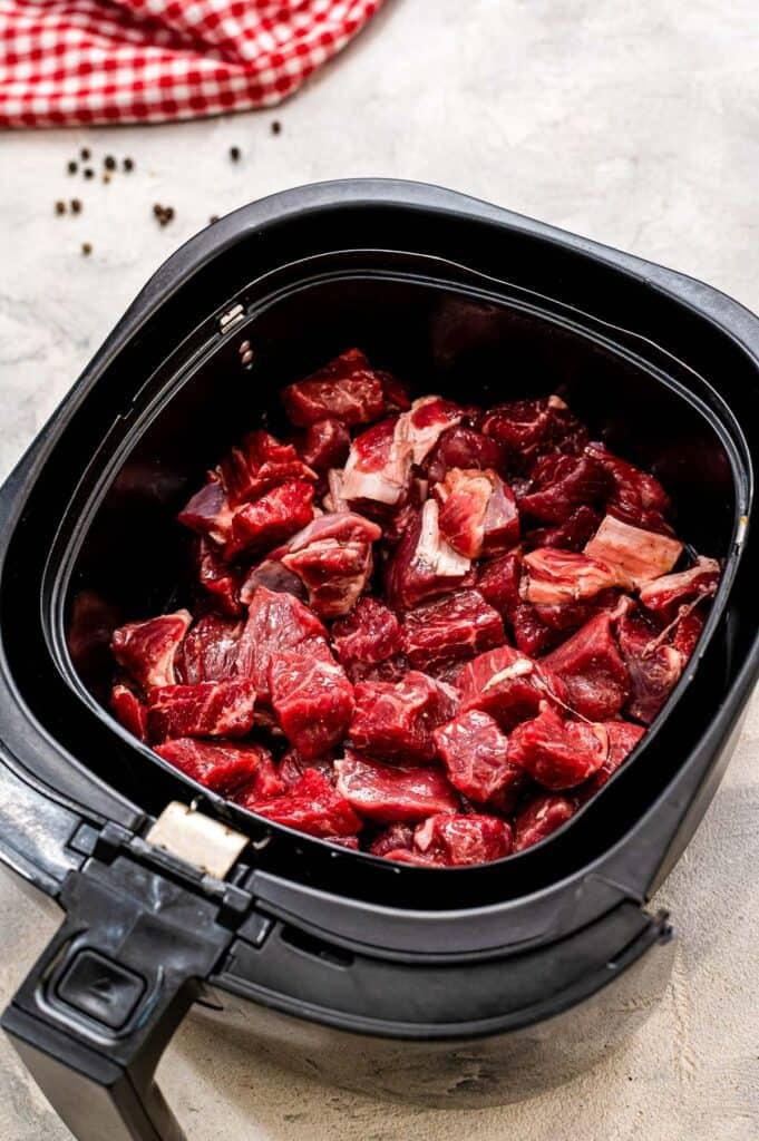 Steak Pieces in Air Fryer Basket