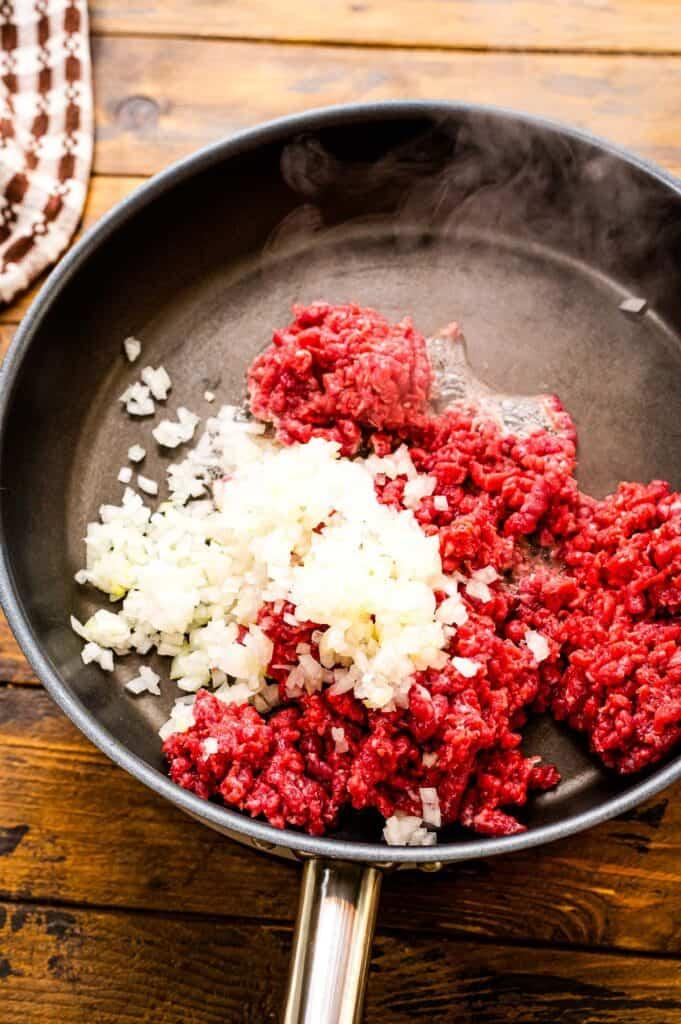 Skillet browning hamburger and onions