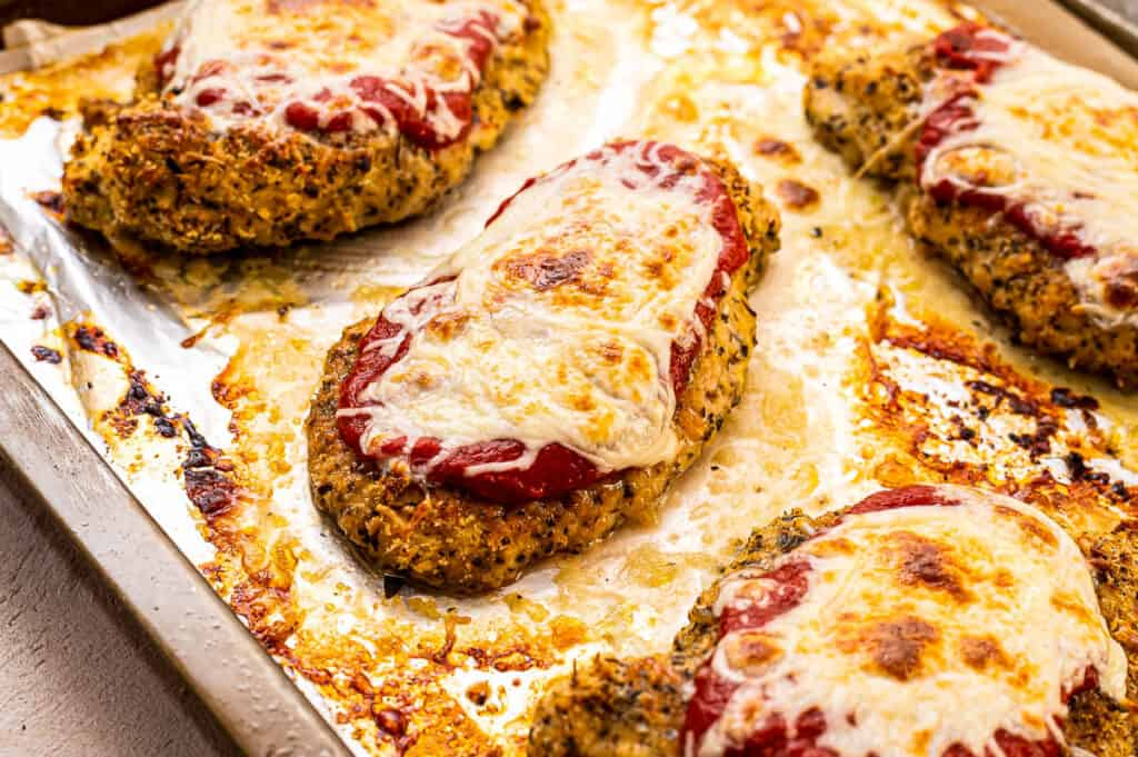 Sheet pan with chicken parmesan on it