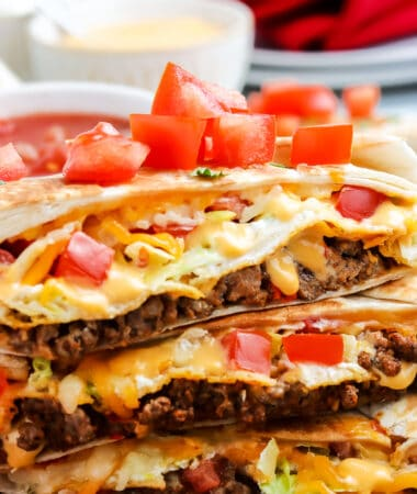 Close up image of Crunchwrap Supreme cut open and stacked