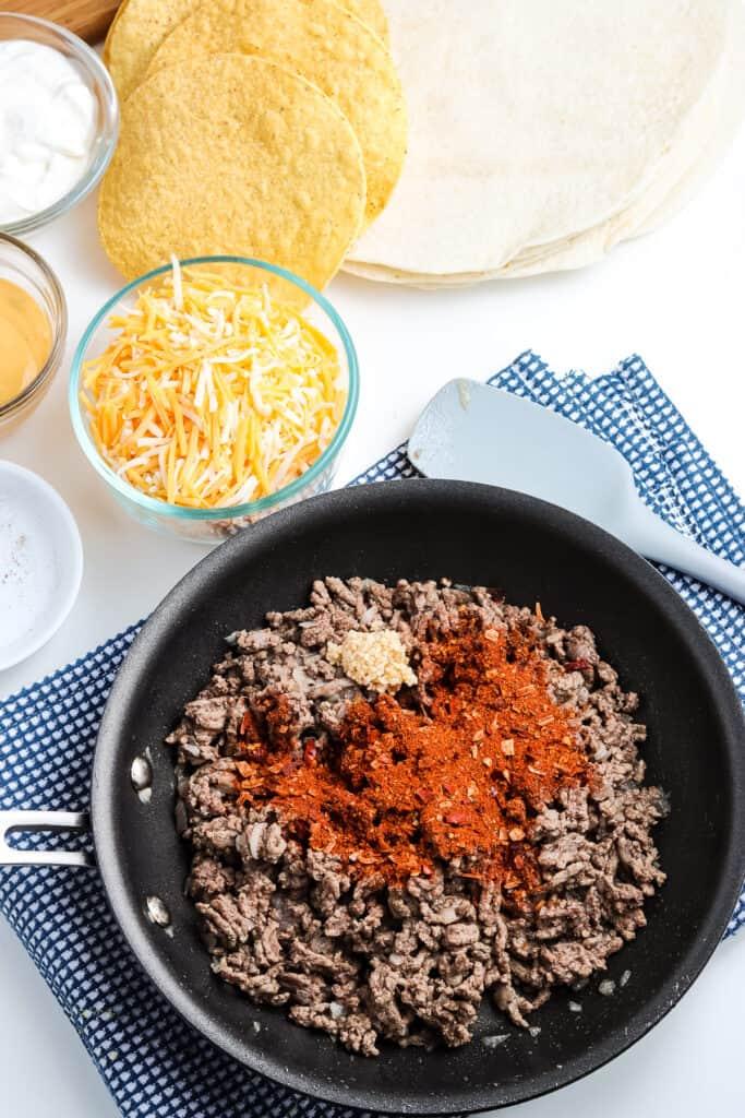 Skillet cooking seasoned taco ground beef