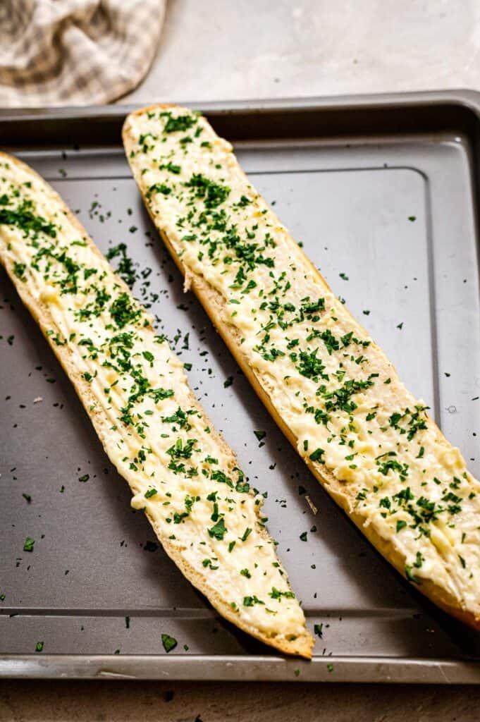 Garlic bread on sheet pan before baking