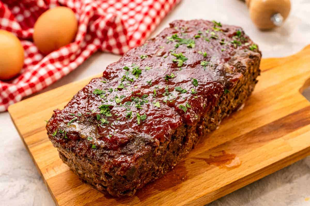 Meatloaf with glaze on cutting board